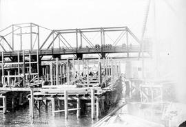 Johnson Street Bridge under construction, completing caisson counterweight trunnion pier