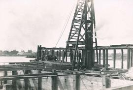 Johnson Street Bridge under construction, driving piles with steam hammer