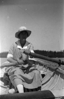 Woman in boat [at Shawnigan Lake?]