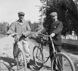 William Edgar Oliver and unidentified friend with bicycles