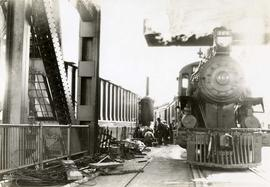 Esquimalt & Nanaimo Railway (E&N) train on railway bridge during Johnson Street Bridge co...