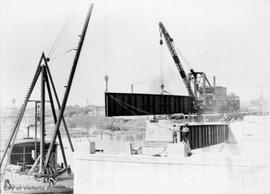 Johnson Street Bridge under construction. placing girder