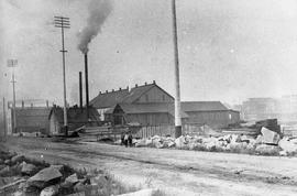 Taylor Mill, 2116 Government Street. Victoria Gas Company in the background. Corner of Pembroke and Government Streets