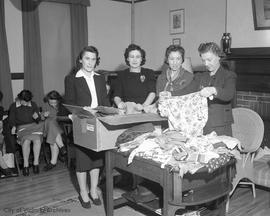 War effort, mending and packing clothes for Britain