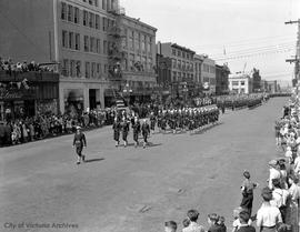 Victoria Day parade on Yates Street, looking west. Sailors from the USS Lotberg followed by RCN detachment