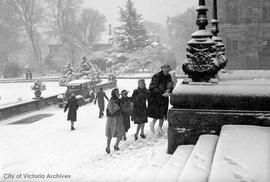 Snow fall.  Civil servants returning to work at the Parliament buildings