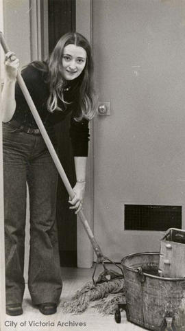 City Archives employee, Linda Eversole, washing the Archives' floor at 613 Pandora Avenue
