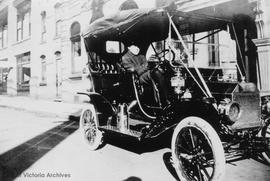 John Sebastian Helmcken, Jr. in a 1910 Ford model T outside 1103 Langley Street